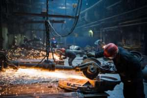 worker welding in dangerous worksites