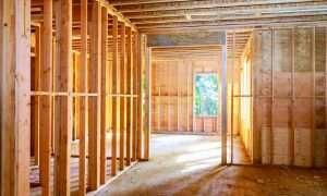 The framed, uncompleted walls of a secure home construction site