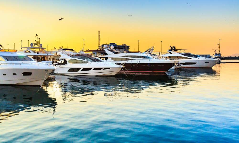Boats are docked at a marina, highlighting the need for marina security to prevent unauthorized visitors from accessing them.