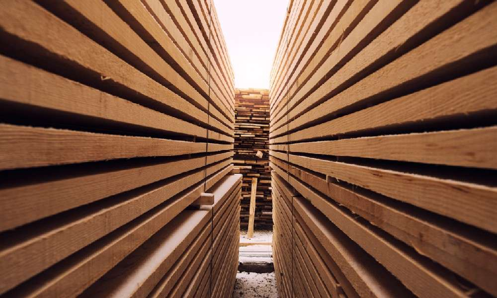Stacks of wooden planks in a lumber yard, exemplifying the need for mobile security